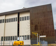 Tall Hangar Door At Airport Maintenance Building. Side Of Hangar With Tall Doors At Airport Maintenance Building stock photos