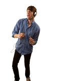 Tall Hipster with Headphones Royalty Free Stock Photography