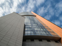 Tall House, Sky and Clouds with a Blank Space. (busness center in a skyscraper Royalty Free Stock Photography
