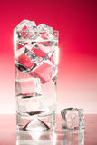 Tall iced drink on red Stock Images