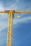 Tall industrial crane stock image