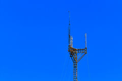 Tall, large, cell phone tower against a blue sky Royalty Free Stock Image