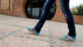 Tall, leggy girl goes through the city 3 stock footage