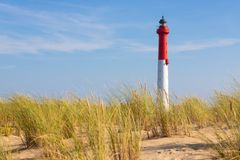 Tall lighthouse in the dunes royalty free stock photography