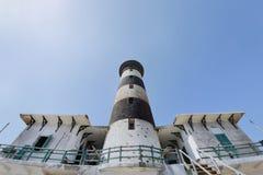 Tall lighthouse on the sea stock photos