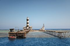 Tall lighthouse on the sea royalty free stock photography