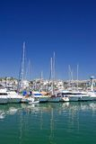 Tall luxury boats and yachts moored in Duquesa port in Spain on Stock Photo
