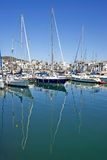 Tall luxury boats and yachts moored in Duquesa port in Spain on Royalty Free Stock Photography