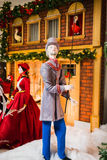 Tall man in christmas street scene Stock Photo