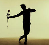Tall man dancing with the rose Stock Photo