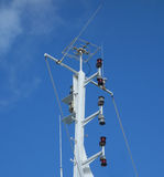The tall mast of a passenger ferry in the windward islands Stock Image