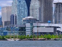 Tall masted schooners gather on Toronto`s waterfront. TORONTO - JUNE 2019: Tall masted schooners gather on Toronto`s waterfront in a festival that occurs every stock photos