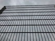 Tall metal fence against a grey sky. Border or prison concept. Stock photo stock photo