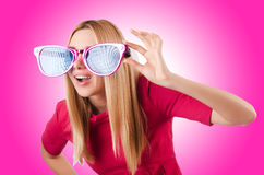 Tall model with giant sunglasses Royalty Free Stock Photo