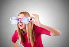 Tall model with giant sunglasses on white Royalty Free Stock Photos