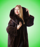 Tall model wearing fur coat Royalty Free Stock Photos