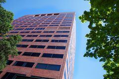 Tall modern brick office building Stock Images