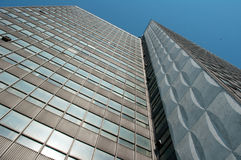 Tall modern building. Tall modern building against the blue sky Stock Image