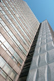 Tall modern building. Tall modern building against the blue sky Royalty Free Stock Photography