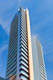 Tall modern multistory house. Under blue sky Stock Image