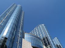 Tall modern office building. Modern glass and steel office buildings Stock Photography