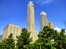 New york city office buildings exterior. Tall modern office buildings exterior against blue sky in New York street United states Stock Photography