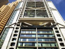 Tall modern office buildings glass exterior. Against blue sky in hongkong china Stock Photos