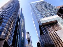 Tall modern office buildings glass exterior. Against blue sky in hongkong china Stock Image