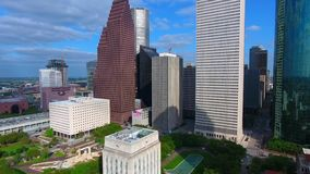Tall modern skyscraper architecture of busy urban financial downtown district of Houston city Texas in 4k aerial view. Tall modern skyscraper architecture of stock video footage