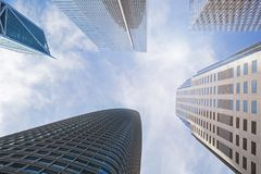 Tall modern skyscrapers over the blue sky Stock Images