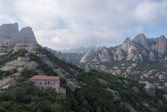 Tall mountain near the monastery of Santa Maria de Montserrat in Stock Photography