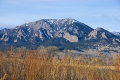 Tall Mountains Above a Field Royalty Free Stock Photography