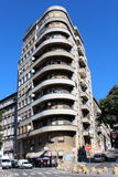 Narrow concrete building with large round balconies Royalty Free Stock Image