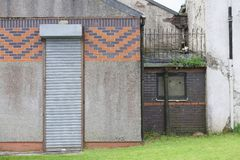 Tall narrow roller shutter door entrance closed shut down royalty free stock photo