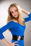 Tall nice young blonde girl with lifted arm Royalty Free Stock Images
