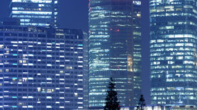 Tall office buildings by night Stock Images