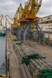Tall orange industrial cranes Stock Image
