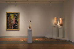 Tall pedestals displaying pottery and art hanging on walls, Portland Art Museum,Maine,2016 Royalty Free Stock Photos