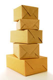 Tall pile of wrapped mail parcels or packages with white background Stock Images