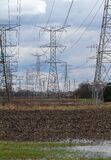 Tall Power Line Towers in Farm Field