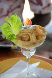 Tall pretty glass with appetizer of fresh Calamari Stock Image