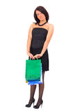 Tall pretty shopping girl somewhat guilty Royalty Free Stock Image