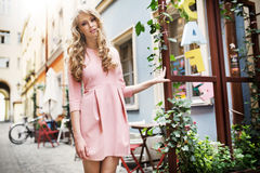 Tall and pretty young model walking in old town Stock Images
