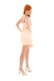 Tall redhead. Picture of tall redhead woman over white Stock Images
