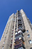 Tall residential building. Tall concrete residential building and deep blue sky Royalty Free Stock Images