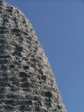 Tall rock. Detail view of tall sculpture on blue sky Stock Photos