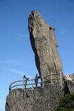 Tall rock formation on cliff Stock Images