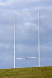 Tall rugby goal posts and blue clouds Royalty Free Stock Images