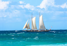 Tall sailing ship with sails on choppy ocean. Royalty Free Stock Image