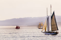 Tall Sailing Ships. This is an image of three historical replica tall sailing ships cruising the ocean at dusk near Victoria, British Columbia, Canada stock photography